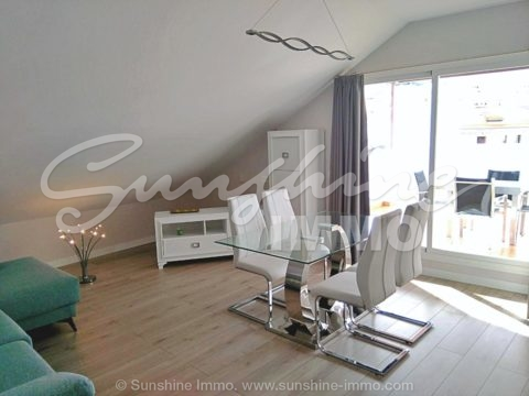 Modern and luxurious top floor apartment in Alhaurin el Grande, centrally located.